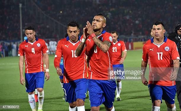 Chile's midfielder Arturo Vidal acknowledges the crowd at the end of the first half of the 2015 Copa America football championship match against...