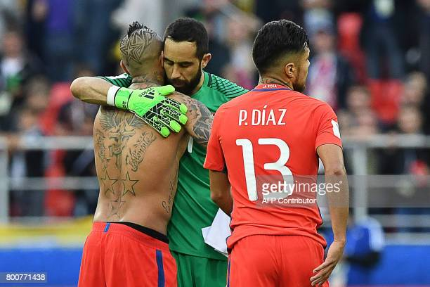 Chile's midfielder Arturo Vidal and Chile's goalkeeper Claudio Bravo congratulate each other after the 2017 Confederations Cup group B football match...