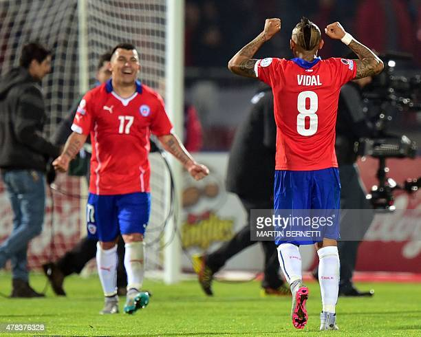 Chile's midfielder Arturo Vidal and defender Gary Medel celebrate after beating Uruguay 10 in their 2015 Copa America football championship...