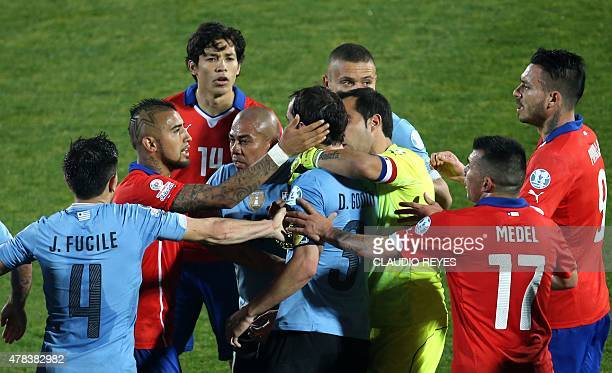 Chile's midfielder Arturo Vidal and Uruguay's defender Diego Godin argue during their 2015 Copa America football championship quarterfinal match in...