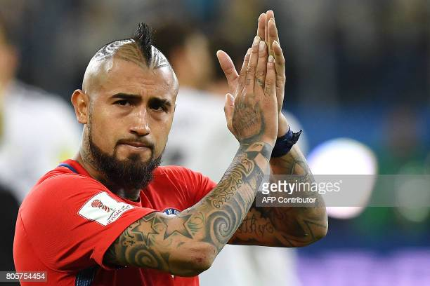 Chile's midfielder Arturo Vidal applauds after the 2017 Confederations Cup final football match between Chile and Germany at the Saint Petersburg...
