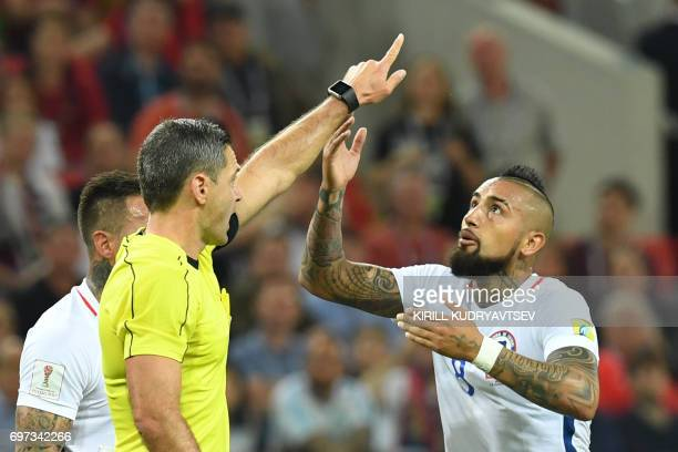 TOPSHOT Chile's midfielder Arturo Vidal argues with Slovenian referee Damir Skomina after a goal was ruled offside during the 2017 Confederations Cup...