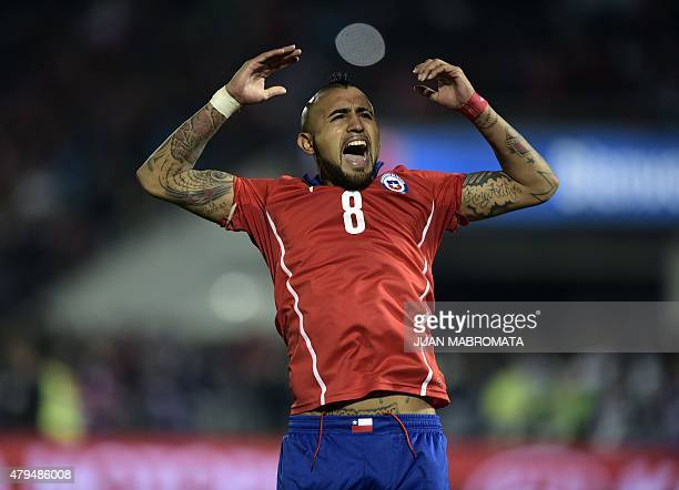 Chile's midfielder Arturo Vidal celebrates after scoring against Argentina during the penalty shootout of the 2015 Copa America football championship...