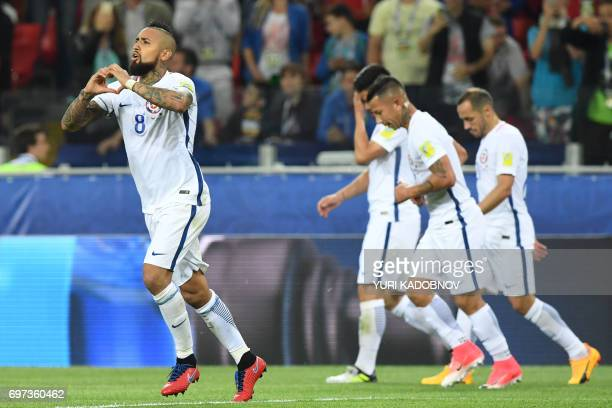 Chile's midfielder Arturo Vidal celebrates with teammates after scoring a goal during the 2017 Confederations Cup group B football match between...