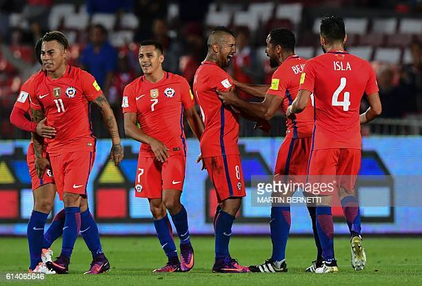Chile's midfielder Arturo Vidal celebrates with teammates after scoring against Peru during their Russia 2018 World Cup qualifier football match in...