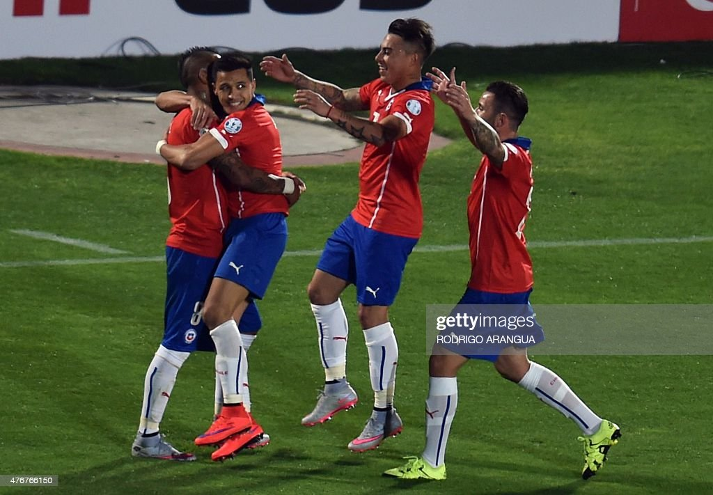 Chile's midfielder Arturo Vidal celebrates with teammates after scoring against Ecuador during the Copa America inauguration football match on June...