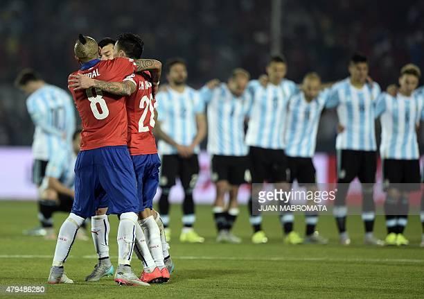 Chile's midfielder Arturo Vidal Chile's midfielder Charles Aranguiz and Chile's defender Gary Medel celebrate after winning the 2015 Copa America...