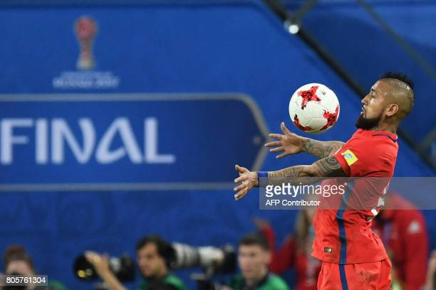 Chile's midfielder Arturo Vidal eyes the ball during the 2017 Confederations Cup final football match between Chile and Germany at the Saint...
