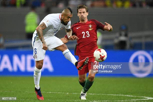 Chile's midfielder Arturo Vidal fights for the ball against Portugal's midfielder Adrien Silva during the 2017 Confederations Cup semifinal football...