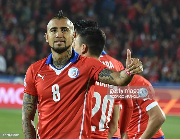 Chile's midfielder Arturo Vidal gestures before the start of the 2015 Copa America football championship match in Santiago on June 19 2015 AFP PHOTO...