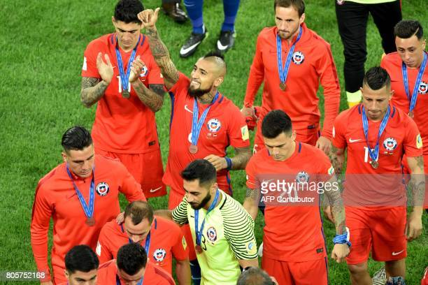 Chile's midfielder Arturo Vidal gives the thumbsup as the team walk on the pitch after Germany won 10 in the 2017 Confederations Cup final football...