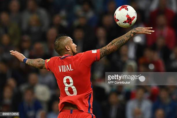 TOPSHOT Chile's midfielder Arturo Vidal jumps for the ball during the 2017 Confederations Cup group B football match between Germany and Chile at the...