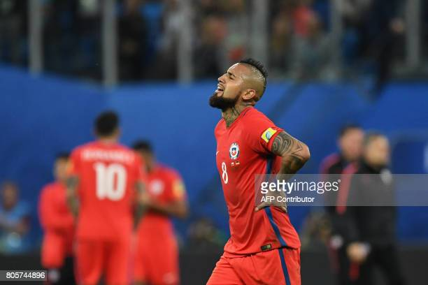 Chile's midfielder Arturo Vidal reacts after Chile defeat during the 2017 Confederations Cup final football match between Chile and Germany at the...