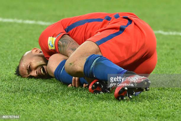 Chile's midfielder Arturo Vidal reacts after falling during the 2017 Confederations Cup final football match between Chile and Germany at the Saint...