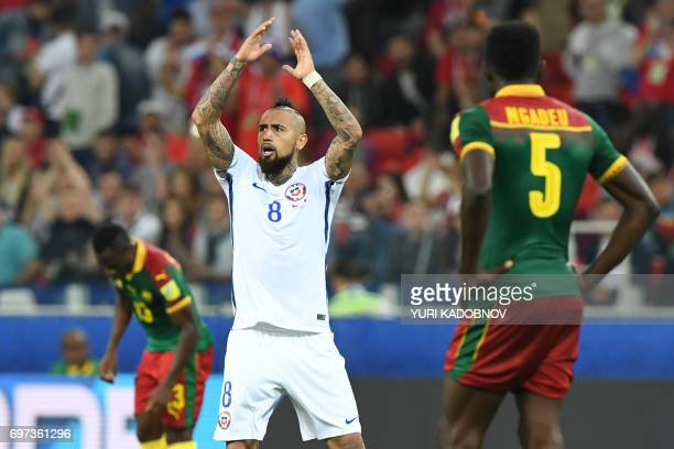 Chile's midfielder Arturo Vidal reacts after scoring a goal during the 2017 Confederations Cup group B football match between Cameroon and Chile at...