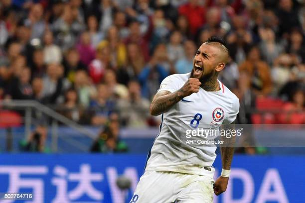 TOPSHOT Chile's midfielder Arturo Vidal reacts after scoring in the penalty shoot out during the 2017 Confederations Cup semifinal football match...