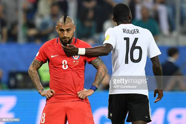 TOPSHOT Chile's midfielder Arturo Vidal reacts next t0 Germany's defender Antonio Ruediger during the 2017 Confederations Cup final football match...