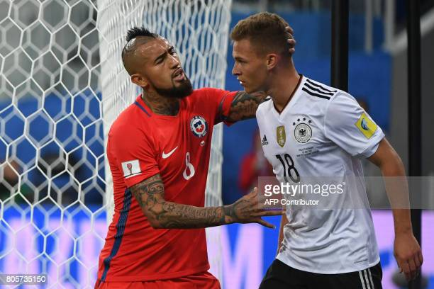 Chile's midfielder Arturo Vidal reacts to Germany's defender Joshua Kimmich during the 2017 Confederations Cup final football match between Chile and...