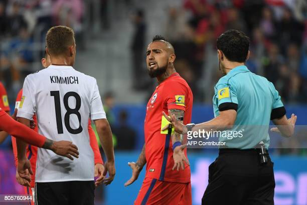 Chile's midfielder Arturo Vidal reacts towards Germany's defender Joshua Kimmich during the 2017 Confederations Cup final football match between...