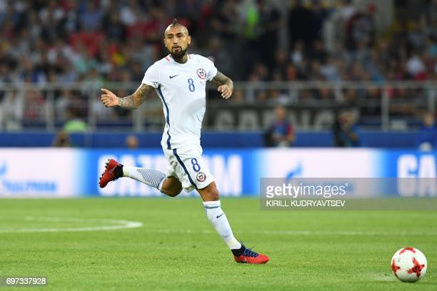 TOPSHOT Chile's midfielder Arturo Vidal runs with the ball during the 2017 Confederations Cup group B football match between Cameroon and Chile at...