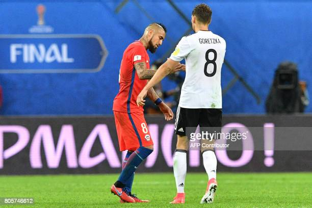 Chile's midfielder Arturo Vidal shakes hands with Germany's midfielder Leon Goretzka after Germany beat Chile 10 to win the 2017 Confederations Cup...
