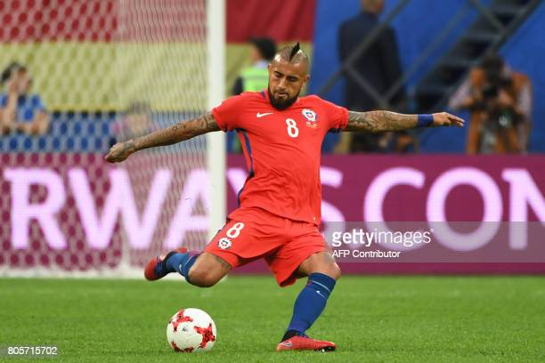 Chile's midfielder Arturo Vidal shoots the ball during the 2017 Confederations Cup final football match between Chile and Germany at the Saint...