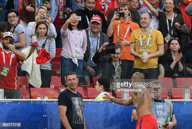 Chile's midfielder Arturo Vidal throws his tee shirt to the crowd after the 2017 Confederations Cup group B football match between Chile and...