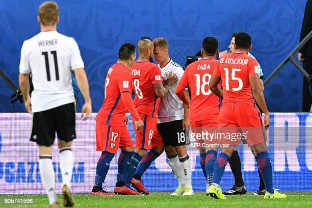 Chile's midfielder Arturo Vidal vies for the ball against Germany's defender Joshua Kimmich during the 2017 Confederations Cup final football match...