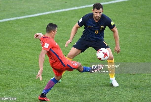 Chile's midfielder Arturo Vidal vies with Australia's defender Bailey Wright during the 2017 Confederations Cup group B football match between Chile...
