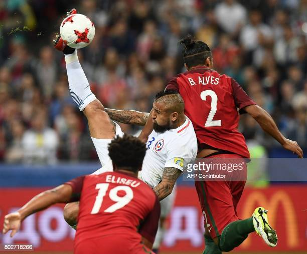 Chile's midfielder Arturo Vidal vies with Portugal's defender Bruno Alves during the 2017 Confederations Cup semifinal football match between...