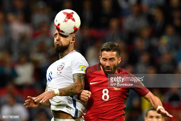 TOPSHOT Chile's midfielder Arturo Vidal vies with Portugal's midfielder Joao Moutinho during the 2017 Confederations Cup semifinal football match...