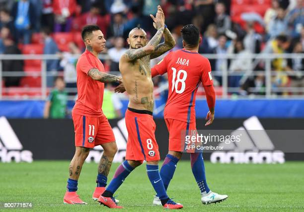 Chile's midfielder Arturo Vidal waves after winning the 2017 Confederations Cup group B football match between Chile and Australia at the Spartak...