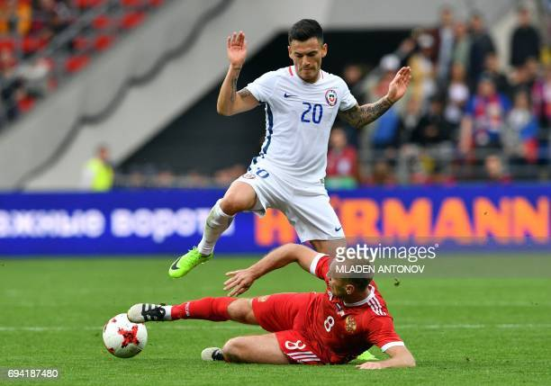Chile's midfielder Charles Aranguiz and Russia's midfielder Denis Glushakov vie for the ball during a friendly football match between Russia and...