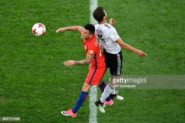Chile's midfielder Charles Aranguiz jumps for the ball against Germany's defender Jonas Hector during the 2017 Confederations Cup final football...