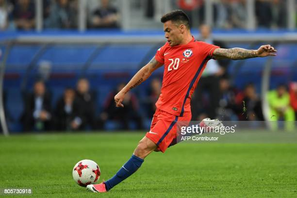 Chile's midfielder Charles Aranguiz shoots the ball during the 2017 Confederations Cup final football match between Chile and Germany at the Saint...