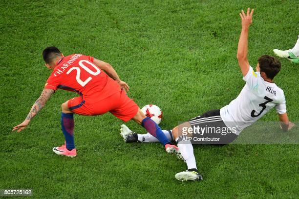 Chile's midfielder Charles Aranguiz vies for the ball against Germany's defender Jonas Hector during the 2017 Confederations Cup final football match...