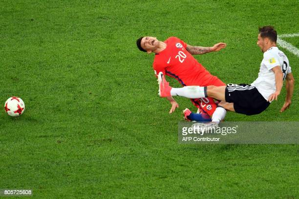 Chile's midfielder Charles Aranguiz vies for the ball against Germany's midfielder Leon Goretzka during the 2017 Confederations Cup final football...
