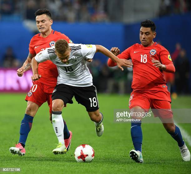 Chile's midfielder Charles Aranguiz vies with Germany's defender Joshua Kimmich and Chile's forward Leonardo Valencia during the 2017 Confederations...