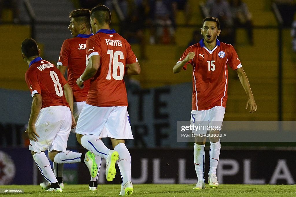 Chile's midfielder Cristian Cuevas (R) celebrates after scoring against Brazil during a South American U-20 football match at Domingo Burgueno stadium in Maldonado, 130 km east of Montevideo, on January 15, 2015.