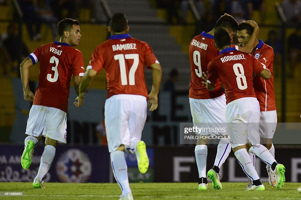 Chile's midfielder Cristian Cuevas (R) celebrates with teammates after scoring against Brazil during a South American U-20 football match at Domingo Burgueno stadium in Maldonado, 130 km east of Montevideo, on January 15, 2015.