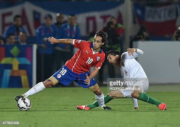 Chile's midfielder Jorge Valdivia and Bolivia's forward Ricardo Pedriel vie during their 2015 Copa America football championship match in Santiago on...