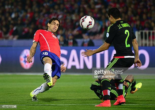 Chile's midfielder Jorge Valdivia and Mexico's defender Julio Cesar Dominguez vie during their 2015 Copa America football championship match in...