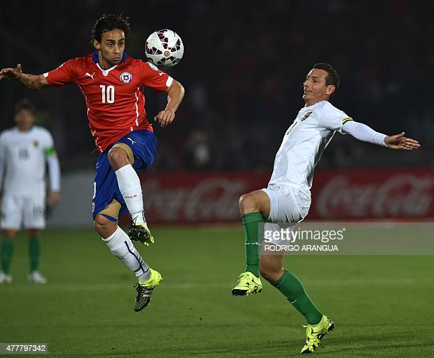 Chile's midfielder Jorge Valdivia controls the ball in the air as Bolivia's midfielder Pablo Escobar looks on during the 2015 Copa America football...