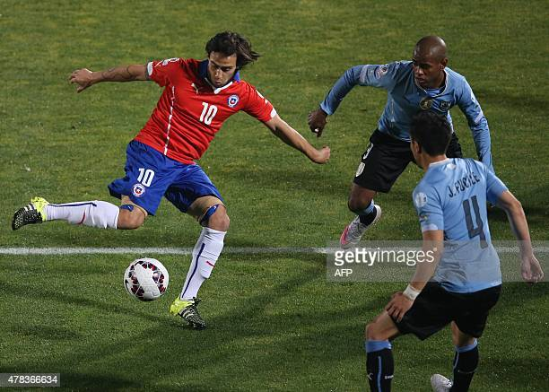 Chile's midfielder Jorge Valdivia vies for the ball with Uruguay's midfielder Jorge Fucile and Uruguay's forward Diego Rolan during their 2015 Copa...