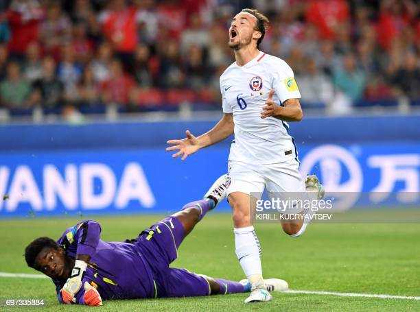 TOPSHOT Chile's midfielder Jose Fuenzalida reacts next to Cameroon's goalkeeper Joseph Ondoa as he misses a goal opportunity during the 2017...