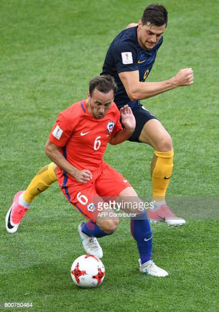 Chile's midfielder Jose Fuenzalida vies with Australia's forward Tomi Juric during the 2017 Confederations Cup group B football match between Chile...