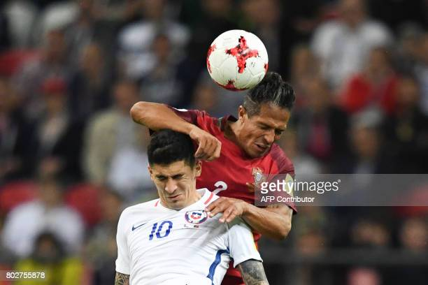 Chile's midfielder Pablo Hernandez fights for the ball against Portugal's defender Bruno Alves during the 2017 Confederations Cup semifinal football...