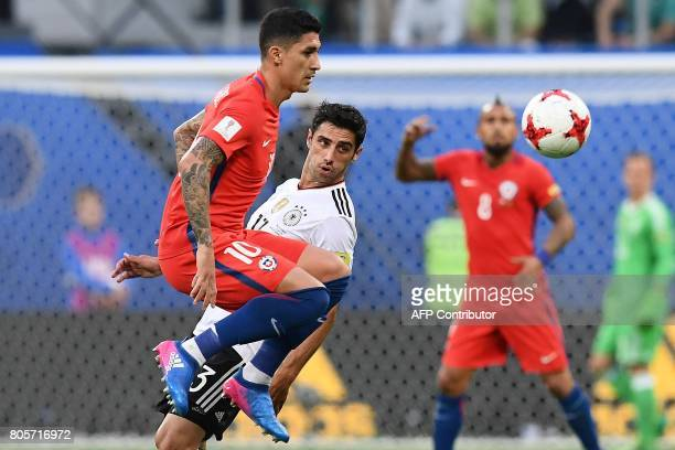 Chile's midfielder Pablo Hernandez fights for the ball against Germany's midfielder Lars Stindl during the 2017 Confederations Cup final football...