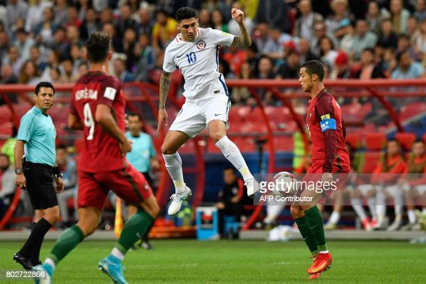 Chile's midfielder Pablo Hernandez jumps for the ball against Portugal's forward Cristiano Ronaldo during the 2017 Confederations Cup semifinal...