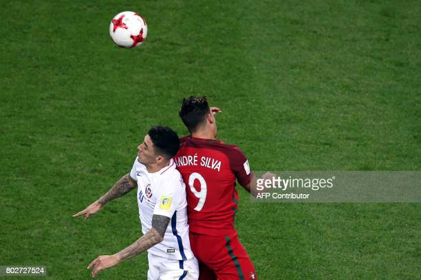 Chile's midfielder Pablo Hernandez jumps for the ball against Portugal's forward Andre Silva during the 2017 Confederations Cup semifinal football...